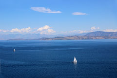 Yacht sailing on the sea. Ionian sea. Sea and mountain view Royalty Free Stock Image