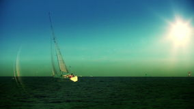 Yacht sailing at sundown. Video footage stock footage