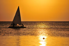 Yacht sailing at sunset Royalty Free Stock Photo