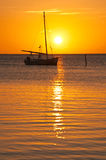 Yacht sailing at sunset Stock Images