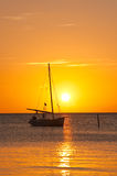 Yacht sailing at sunset Stock Photography