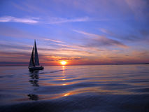 Yacht sailing at sunset