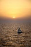 Yacht sailing at sunset Royalty Free Stock Images