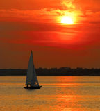 Yacht sailing into sunset Royalty Free Stock Photography