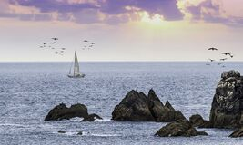 A yacht sailing at sunset