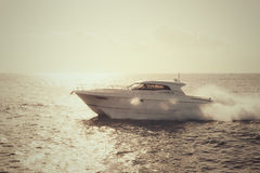 Yacht sailing in sunset light Royalty Free Stock Photos