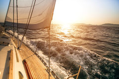 Yacht sailing during sunset Royalty Free Stock Photos