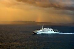 Yacht sailing at sunset Royalty Free Stock Photos