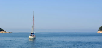 Yacht sailing toward Elephite Islands. Stock Images