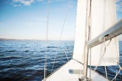 Yacht sailing towards the sunset Royalty Free Stock Images