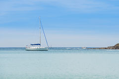 Yacht sailing on tropical sea at windy day Stock Photos