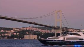 Yacht sailing under the bridge stock video footage