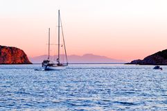 Yacht sailing in Vathi harbour Royalty Free Stock Photos