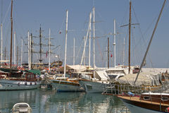 Yacht and sailing vessels anchored in the port Royalty Free Stock Image