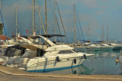 Yacht and sailing vessels anchored in the port Stock Images