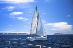 Yacht sails with beautiful cloudless sky. Luxury yacht. Stock Photos