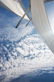 Yacht sails, cloudy sky Royalty Free Stock Photo