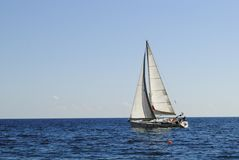 Yacht. A yacht with sails] elevated in the sea stock photography