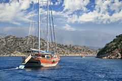 The yacht sails between islands in the Aegean Sea Stock Photos
