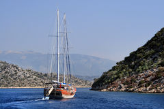 The yacht sails between islands in the Aegean Sea Royalty Free Stock Photography