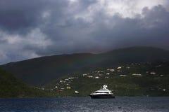 Yacht sails out of Virgin Gorda, British Virgin Islands royalty free stock image