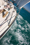 Yacht sails under fresh wind. Classic yacht sails to an island under fresh wind. Auckland, New Zealand royalty free stock images