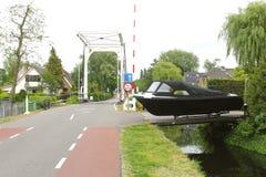 Luxury yacht for sale in Kortenhoef, Netherlands. Small village Kortenhoef with a yacht for sale and an old wooden drawbridge, Holland Stock Photos