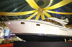 Yacht for sale in showroom. Huge yacht dispayed for sale in a showroom Royalty Free Stock Images