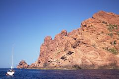 Yacht in scandola rocks Stock Image