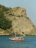 Yacht in sea. Yacht and cliff in sea Royalty Free Stock Photos
