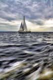Yacht in the sea. On a stormy day Royalty Free Stock Photos