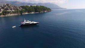 Yacht in the sea, aerial photography drone, Budva, near Dukley G. Ardens, Adriatic Sea, Montenegro, Balkans stock video