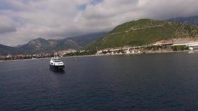 Yacht in the sea, aerial photography drone, Budva, near Dukley G. Ardens, Adriatic Sea, Montenegro, Balkans stock footage