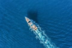 Yacht at the sea. Aerial view of luxury floating ship stock images