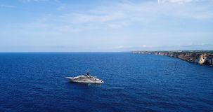 Yacht at sea in aerial view. In mediterranean Royalty Free Stock Photos