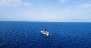 Yacht at sea in aerial view. In mediterranean Royalty Free Stock Photography