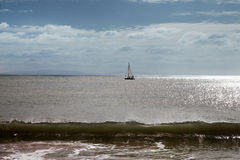 Yacht in sea. Alone yacht in the sea Royalty Free Stock Photo