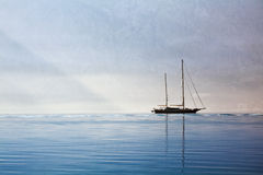 Yacht in the sea on the background of the misty mountains Stock Images