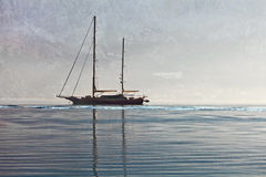 Yacht in the sea on the background of the misty mountains Royalty Free Stock Photography