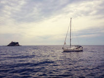 Yacht in the sea. In calm day Royalty Free Stock Photos