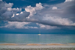 Yacht, sea and cloud Stock Photos