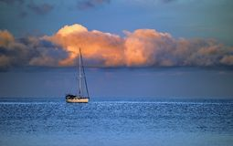 Yacht, sea and cloud Stock Photography