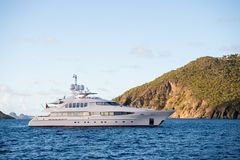 Yacht at sea coast on sunny blue sky in gustavia, st.barts. Yachting and sailing adventure. Luxury travel and voyage on boat. Summ Royalty Free Stock Photography