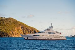 Yacht at sea coast on sunny blue sky in gustavia, st.barts. Yachting and sailing adventure. Luxury travel and voyage on. Boat. Summer vacation on tropical royalty free stock photography