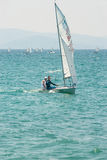 Yacht in the sea: the girl with a trainer in Pomorie. Bulgaria Stock Photo