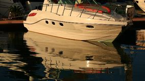 Yacht and sea - harmony of reflections. Reflection of a yacht in the sea at sunset, waves stock video