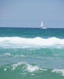 Yacht on the sea horizon royalty free stock image