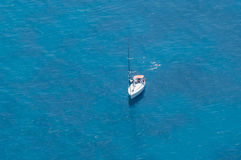 Yacht At Sea. Single yacht moored in a clear blue lagoon Stock Photography