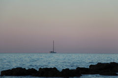 Yacht in the sea at sunrise. Stock Photography