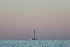 Yacht in the sea at sunrise. Royalty Free Stock Photography